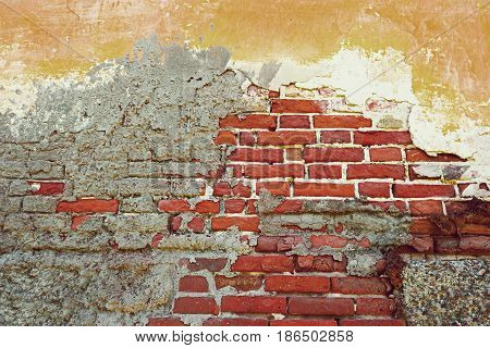 Old Exterior Brick Wall Half Weathered Plaster, Copy Space