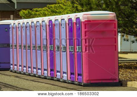 Colorful Portable Restrooms In A Row Outside