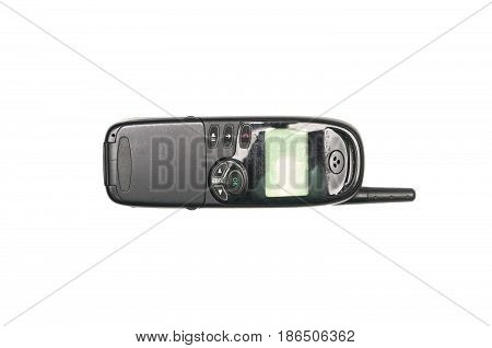 Old mobile phone with buttons key isolated on white background.