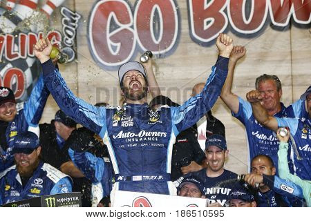 May 13, 2017 - Kansas City, Kansas, USA: Martin Truex Jr. (78) takes the checkered flag and wins the Go Bowling 400 at Kansas Speedway.
