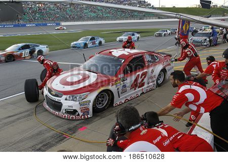 May 13, 2017 - Kansas City, Kansas, USA: Kyle Larson (42) comes to pit road for service during the Go Bowling 400 at Kansas Speedway.