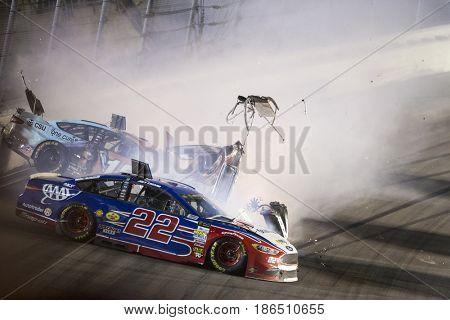 May 13, 2017 - Kansas City, Kansas, USA: Joey Logano (22) and Danica Patrick (10) wreck during the Go Bowling 400 at Kansas Speedway.
