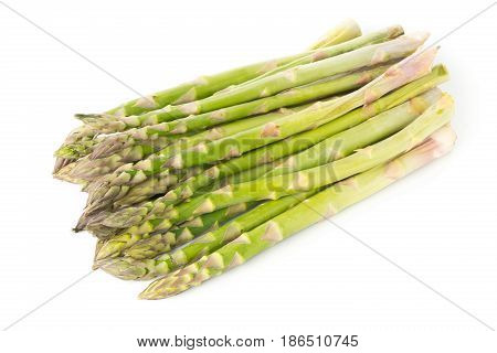 Bundle of fresh cut raw uncooked green asparagus vegetable on white background