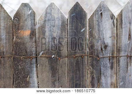Wooden Fence In The Winter. Snow In Motion. Old Wooden Boards, Perfect Background For Your Concept O