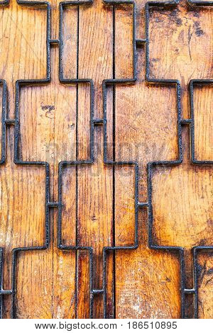 Metal Grille Painted With Black Paint On Wooden Door. Old Wood Planks, Perfect Background For Your C
