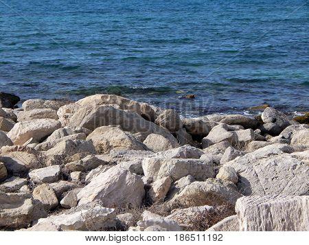 Rocky beach of the sea. Caspian Sea.