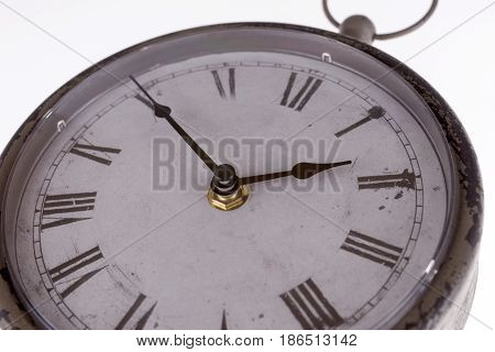 Vintage clock with roman numerals isolated on white
