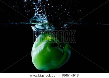 Green Bell Sweet Pepper Droped Into Water