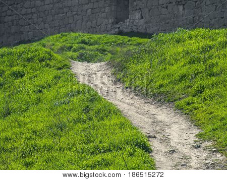 A path among the green mountains near the fortress