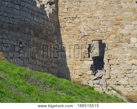 The destroyed wall of the old Genoese fortress