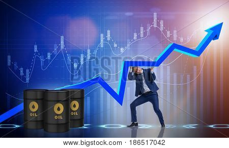 Businessman supporting oil price in business concept