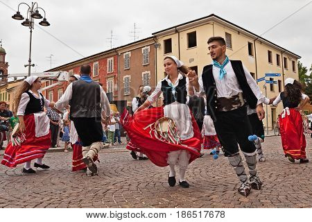 RUSSI, RA, ITALY - AUGUST 2: the folk dance ensemble Irizema from Bova Marina, Calabria, Italy performs traditional dance tarantella in the town square during the International Folklore Festival on August 2, 2015 in Russi, Ravenna, Italy