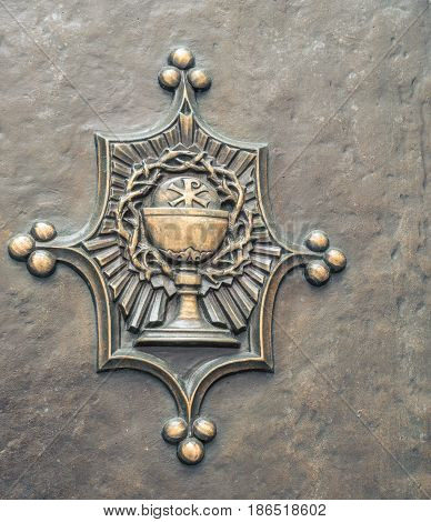 Chalice cup on a  church door in new york city