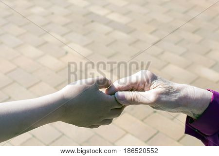 Grandma's hand to walk to the garden outside.