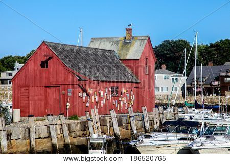 ROCKPORT-AUGUST 08:  A view of Rockport Harbour and the red building know as Motif Number One, Rockport, Massachusetts, New England, USA on August 08, 2014.