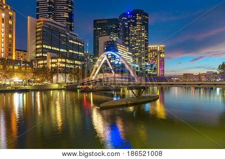 Beautiful Cityscape At Night With Bridge Across River