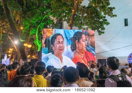 KOLKATA WEST BENGAL INDIA - 9TH MAY 2017 : Chief Minister of West Bengal Ms. Mamata Banerjee smiling to the audience from screen at Rabindra Jayanti celebration (birthday of Late Poet Rabindranath Tagore).