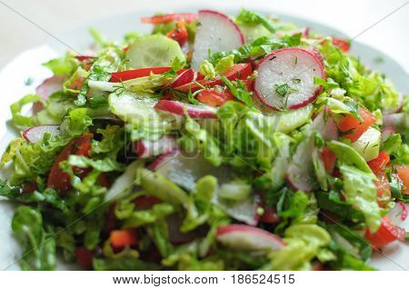 Spring Vegan Salad With Tomato, Cucumbers, Radish And Chinese Cabbage