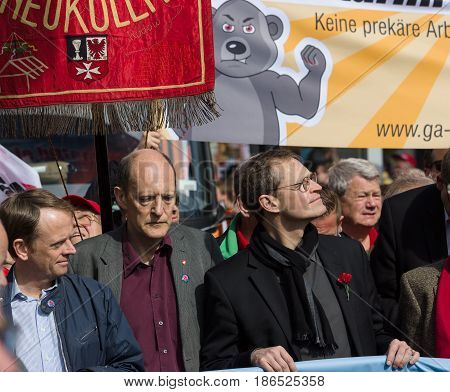 BERLIN - MAY 01 2016: Governing Mayor of Berlin Michael Mueller (right). Members of trade unions workers and employees at the demonstration on the occasion of Labour day.