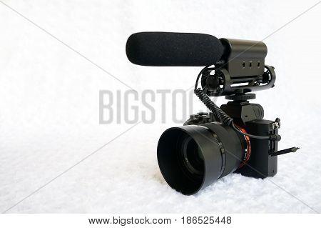 Professional mirrorless digital video camera with shotgun microphone