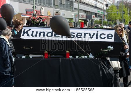 BERLIN - MAY 01 2016: The funeral of customer service. Members of trade unions workers and employees at the demonstration on the occasion of Labour day.