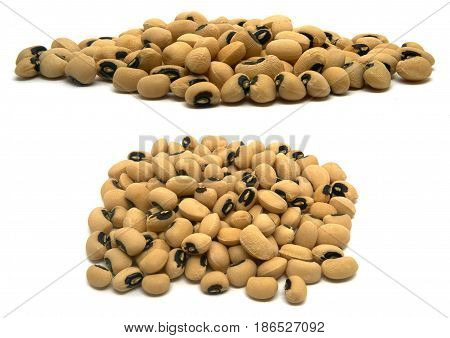 A small handful of Black eye beans. Beans isolated on a white background. Close-up.