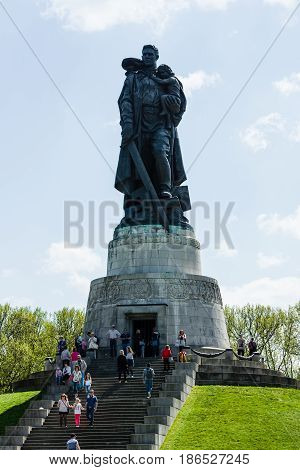 BERLIN - MAY 08 2016: Victory in Europe Day. Treptower Park. Soviet War Memorial (Monument to the Liberator Soldier) and numerous guests and visitors.