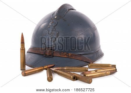 french military helmet of the First World War with ammunition isolated on white background