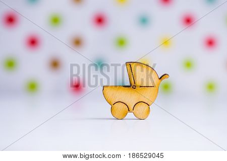Wooden Icon Of Baby Buggy On Spotted Background