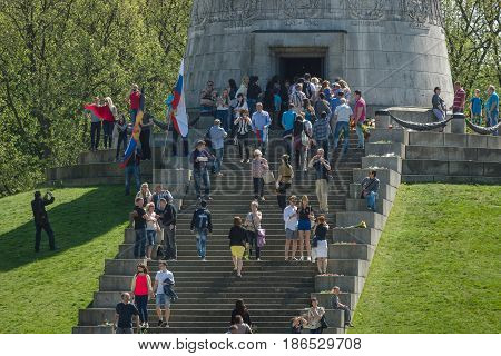 BERLIN - MAY 09 2016: Victory Day in Treptower Park. Guests and visitors at the foot of the monument to the Liberator Soldier.