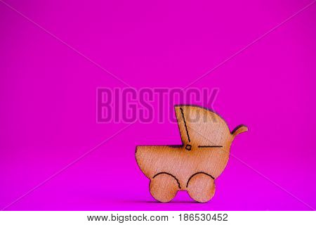 Wooden Icon Of Baby Buggy On Crimson Background