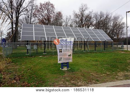 NEW BUFFALO, MICHIGAN / UNITED STATES - NOVEMBER 20, 2016: A sign extols recreational opportunities in the state of Michigan, in front of solar panels at the New Buffalo Welcome Center 707.