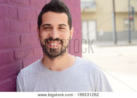 Portrait of young latin man. Urban scene.