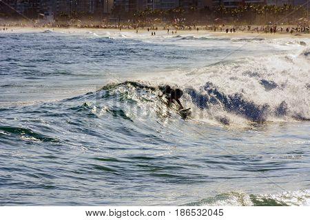 Surfer on Ipanema beach at Rio de Janeiro