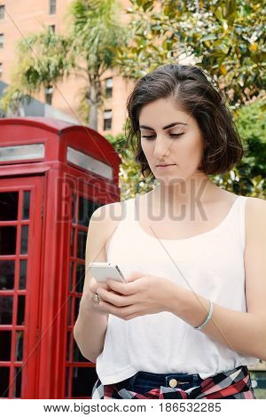 Young Woman Sending Messages With Her Smartphone.
