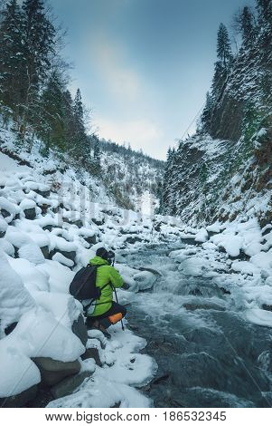 Photographer On A Rocky Mountain River