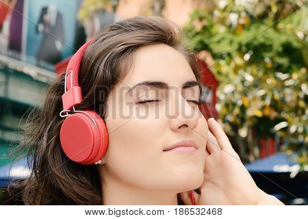 Young Woman With Red Headphones.
