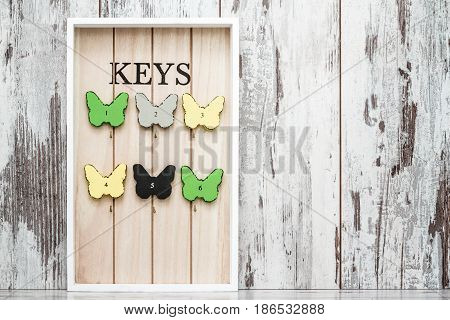 Key Chain Holder On White Wooden Background