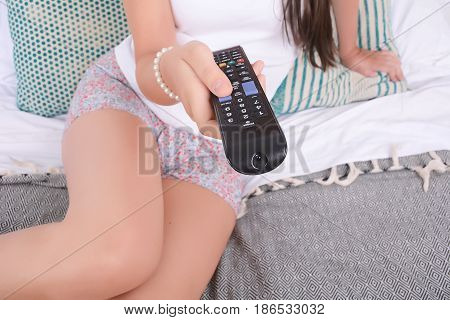 Woman Watch Tv In Bed.