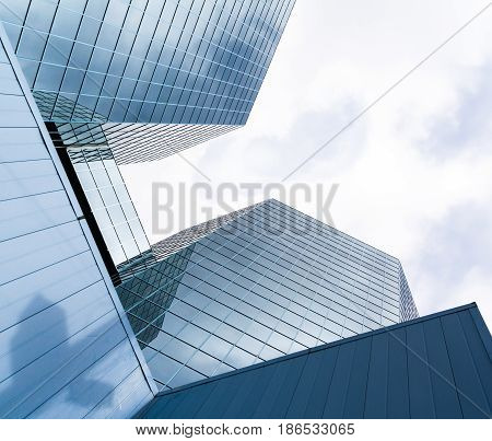 Two Skyscrapers reflecting clouds and sky in the glass fronts. The Commerce Place buildings in Hamilton, Ontario, Canada. CIBC. Canadian Imperial Bank of Commerce. FEBRUARY 2009.