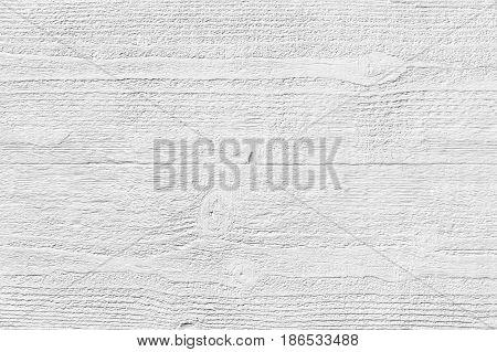 White textured molded gypsum panel on wood