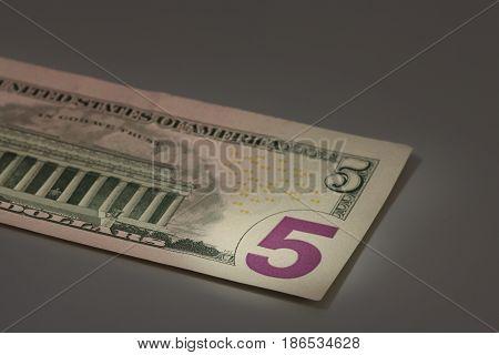 number 5 on american dollar bill macro shot