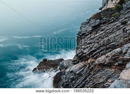 waves and rocks. blue sea water on volcanic cliff.