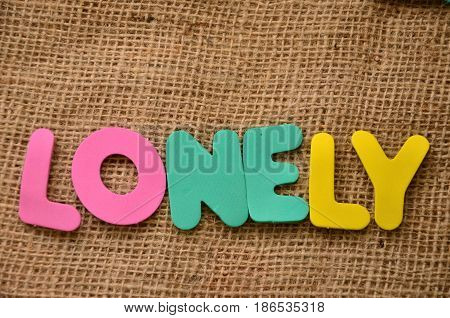 word lonely on a  abstract colorful background