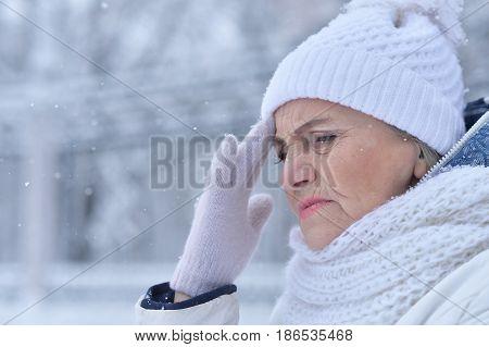 Poor health of senior woman in snowy winter