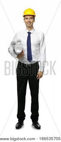Young engineer holding blueprints on white background
