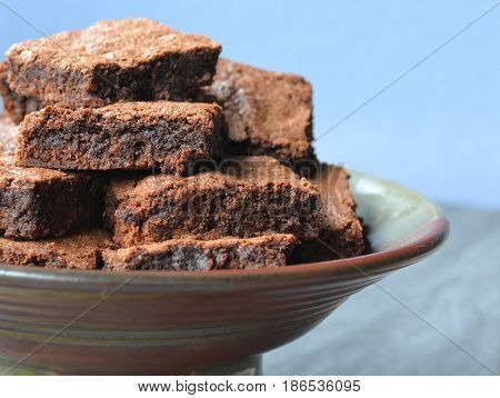 Chocolate Fudge Brownies Piled on a Plate: Close up, side view.