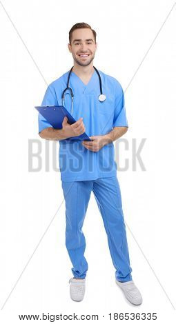 Handsome young medical assistant with clipboard on white background