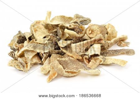 closeup of a pile of crispy fried codfish skin served as snacks on a white background