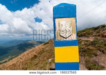 Ukraine border. Frontier in Carpatian mountains, as a symbol of visa-free regime with Europe. Open Ukraine and Europian Union travel concept.